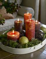 Lys og detaljer i matchende farger som  tekstilene er dekorative elementer.