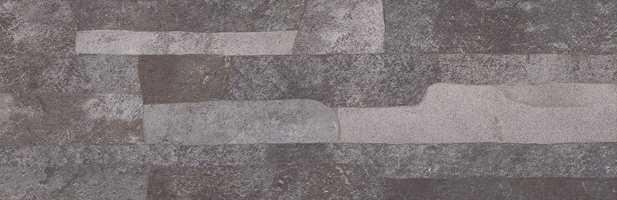 Front er en serie vanlige fliser med dekor som etterligner naturstein.