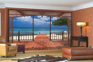 Få følelsen av at du er på stranden midt inn i stuen! Tapetet heter El Paradiso.