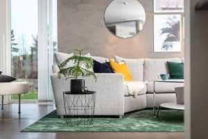 <b>STIL:</b> Farge, form og teppets materiale bidrar til å skape stilen. Et grønt teppe harmonerer godt med natur og grønne planter. Teppet Atelje er fra Golvabia.