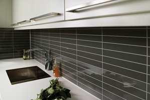 Området mellom kjøkkenbenken og overskapene er ofte den siste biten som faller på plass ved oppussing.