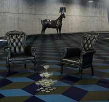 <b>TAKTILT:</b> Et tekstilgulv i mørke farger kan lune og skape atmosfære i kjelleretasjen. Teppegulvet er Fletco fra Forbo. (Foto: Forbo Flooring)