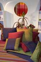 Også her en god miks av farger, ikke minst i sengeteppet, men noe mer avdempet i tonene i forhold til foregående bilder. (Michel Viaud)