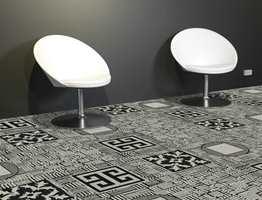 Miks av mønstre. Dette gulvet er en kombinasjon av 4 ulike teppeflismønstre; Jailhouse, Ink Blot, A maze og Slam Dunk for ekstra effekt i dette offentlige miljøet hvor gulvet kan få hele oppmerksomheten. Fra Black & White-kolleksjonen til Interface.