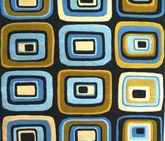 Retromønstre på designtepper - her et utsnitt. Mønstrene er håndkarvet, også på de maskinproduserte tepper.