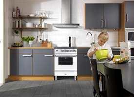 Gjør kjøkkenet til et hyggelig rom for store og små. Her med mosaikk fra Golvabia.