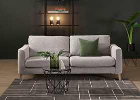 <b>GRÅ SOFA:</b> Den grå sofaen blir flott mot en dyp grågrønn vegg og med litt grønt tilbehør. Interiøret er fra Bohus. (Foto: Bohus)