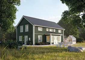 Det grønne blir sterkere og heller mot blått når den kommer opp på huset.