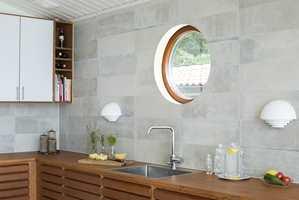 Met fliser i betonglook skapes et stilrent, industrielt interiør som passer til moderne og funkisinspirert arkiteketur. Dette er Masquat, fra Golvabia.
