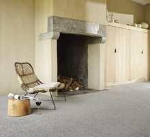 <b>BEHAGELIG:</b> Med teppe på gulvet får du det både varmt, lunt og behagelig. (Foto: Musum Interiør)