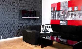 En anelse rødt tilfører temperament til den sobre skalaen av sort, hvitt og naturtoner.