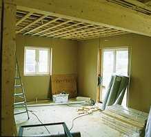 Kjøkkenet før det ble innredet og fargesatt.