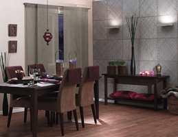 Her er en spisestue med mørkt treverk, bambus og enkle linjer. En etnisk stil.