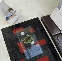 Ellers er teppefliser en god løsning. Dette teppet er fra Interface.