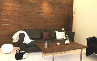 Beiset panel brukt som fondvegg, i kombinasjon med det lyse i rommet.  Foto: Jotun