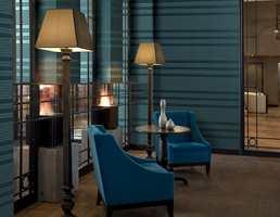 Blåe, horisontale striper kan få rommet til å virke lenger og skaper en sval atmosfære. Kolleksjonenen heter Manhatten og er fra Intag.