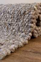 <b>HÅNDVEVD:</b> Håndvevde gulvtepper laget av tovet ull gir et slitesterkt og varmt underlag. (Foto: Teppeabo)
