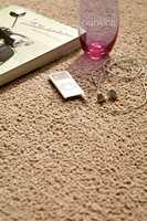 Heldekkende teppe er et godt alternativ og gir stuen din det særpreg du er ute etter.