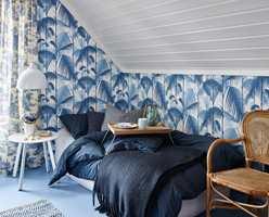 <b>KVISTROMMET:</b> Her har Christine Hærra mikset ulike mønster. Med to farger og ensfarget tak og gulv er det likevel ro.