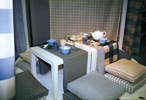 Kombinasjonen av blått, hvitt og sand gir en lun stemning, samtidig som det oppleves kjølig og friskt.