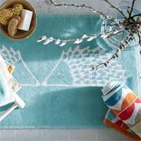 Nye tekstiler på baderommet kan gjøre den store forskjellen. (Foto: Tapethuset)