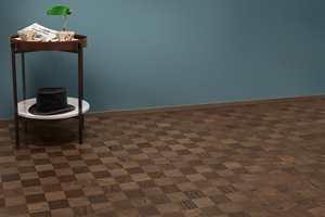 <b>PÅ GULVET:</b> Fargen på veggen skaper ikke automatisk et lunt interiør alene. Et mørkt, mønstret parkettgulv mot en mørkere vegg gir dybde og liv til rommet og skaper helhet. Gulv: Noble Oak Chelsea fra Tarkett. (Foto: Tarkett)