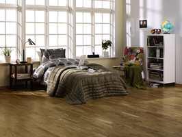 Et klassisk parkettgulv kan fint kombineres med moderne møbler og interiør.