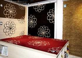 Ornamenter og store blomster på avpassede tepper fra Gulvex.