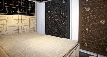 Avpasset teppe hører med i en møbelsetting. Her wilton-tepper i brunt, beige og sort. (Fra Gulvex)