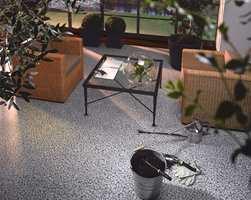 En hjørneløsning i stue med mønster i rullestein. (Fra Polyflor)