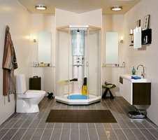 God utnyttelse av plassen. En mørkere flis på gulv enn på vegg er veldig vanlig i norske bad. På baderomsmøbel kombineres mørk eik med hvitt. (Fra Porsgrund Bad)