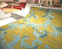 Fra årets Domotex i Hannover - verdens største teppemesse: Stilfulle tepper i pastellfarger med typiske ornamenter i lys blå og turkis.