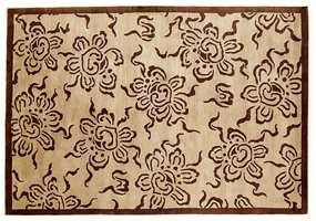 Blomstermønster i brunt og beige - tradisjonsteppe som passer i dagens trendbilde.